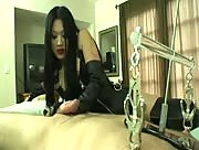 Asian Goddes Miki Gives a Slave a Handjob