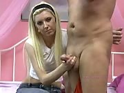 Cute petite blonde gives a very lucky guy a great handjob