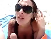 Hot chick sucks and jerks on the beach.