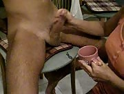 dude gets jerked off into a coffee cup by a cute amateur