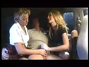 Two hot girls jerk off a lucky dude in the back of a car